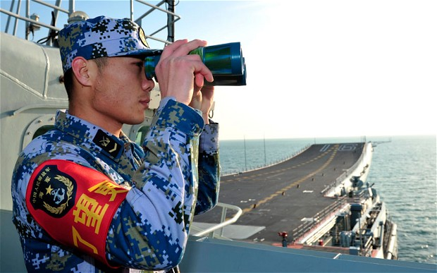 A naval soldier onboard China's first aircraft carrier 'Liaoning' Photo: Reuters