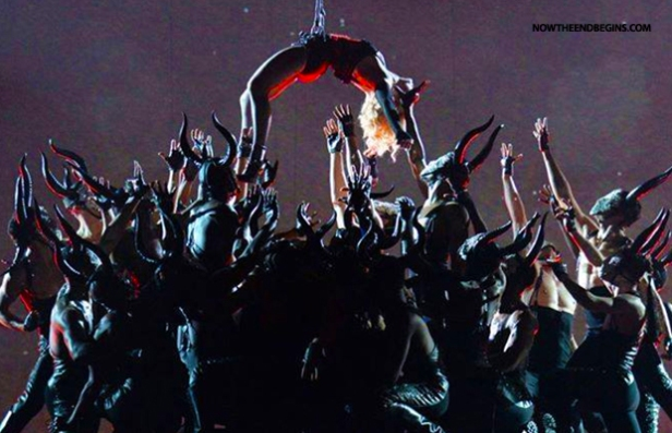 Madonna finished her song by being pulled up into the air, suspended above her demons
