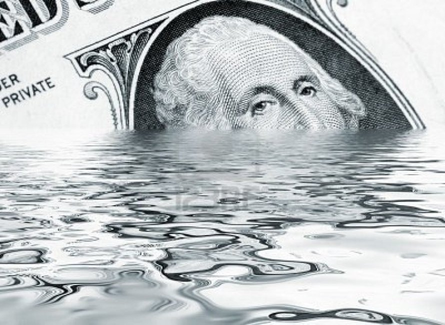 5029344-money-concept-showing-us-dollar-sinking-in-water