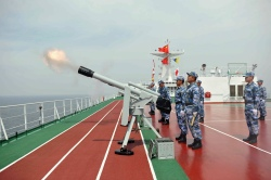 PLA Navy fires a salute during a commemoration ceremony for Chinese soldiers killed during the First Sino-Japanese War, near Liugong island in Weihai